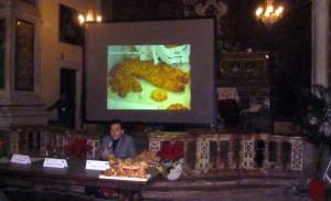 Giusppe  Floresta  illustar una slide